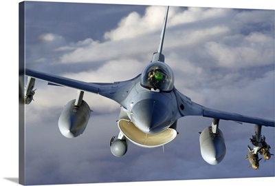An F16 Fighting Falcon soars through the sky