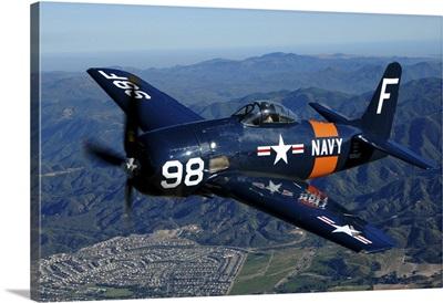 An F8F Bearcat flying over Chino, California