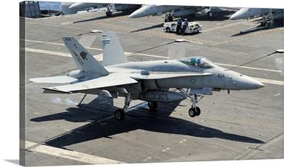 An F/A-18 Hornet of the U.S. Navy landing aboard USS Eisenhower