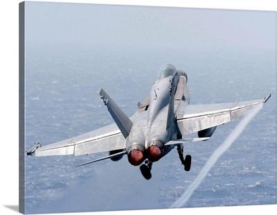 An F/A-18 Hornet taking off