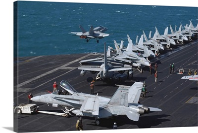 An F/A-18C Hornet launches from the flight deck aboard USS Theodore Roosevelt