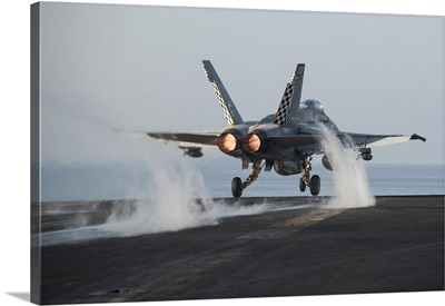 An F/A-18C Hornet launches from USS Harry S. Truman