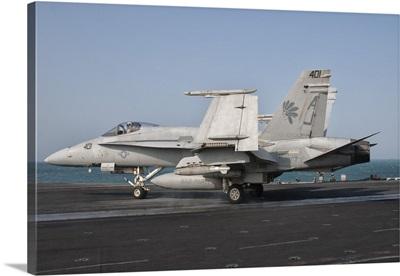 An F/A-18C Hornet on the flight deck of USS George H.W. Bush