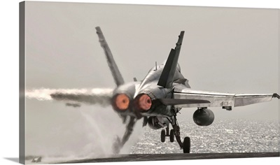 An F/A-18C Hornet takes off from USS George H.W. Bush