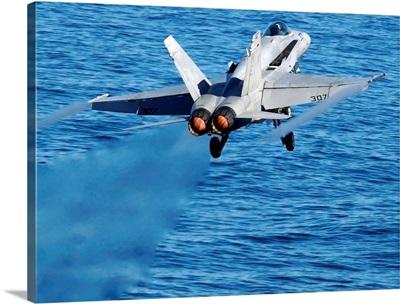 An F/A-18C Hornet taking off