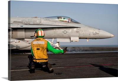 An F/A-18C is ready to launch from the flight deck of USS Eisenhower