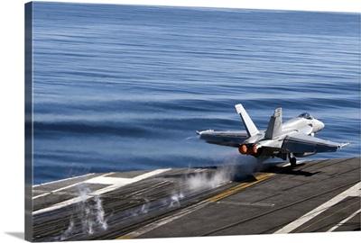 An F/A 18E Super Hornet launches from the flight deck of USS Carl Vinson