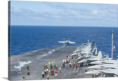 An F/A-18E Super Hornet launches from the flight deck of USS George Washington