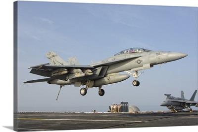 An F/A-18E Super Hornet makes an arrested landing aboard an aircraft carrier