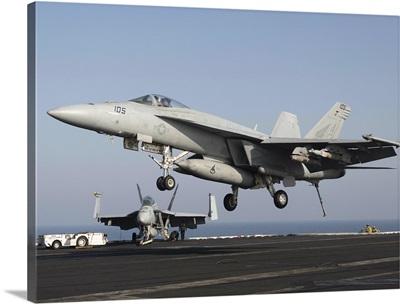 An F/A-18E Super Hornet prepares for landing aboard USS Dwight D. Eisenhower