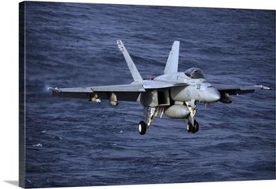 An F/A-18E Super Hornet prepares to make an arrested landing
