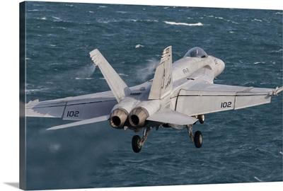 An F/A-18E Super Hornet taking off from USS George H.W. Bush