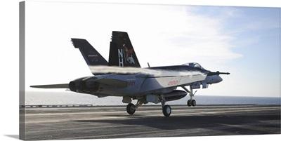 An F/A-18E Super Hornet touches the flight deck of USS Nimitz