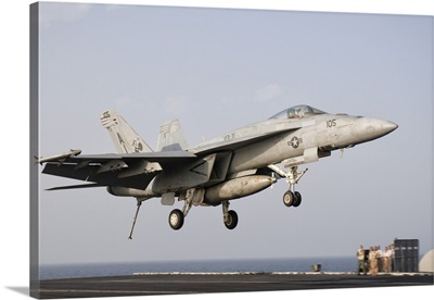 An F/A-18E Super Hornet trap landing aboard USS George H.W. Bush