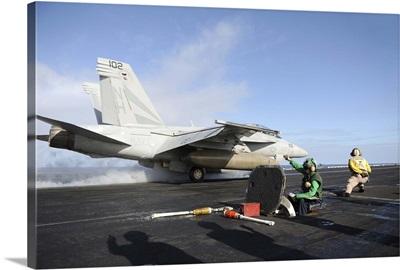 An F/A-18F Super Hornet launches from USS Nimitz