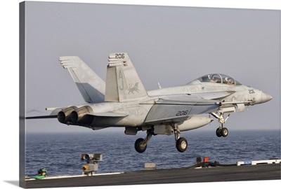 An F/A-18F Super Hornet launches off the flight deck of USS George H.W. Bush
