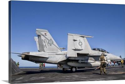 An F/A-18F Super Hornet moves into launch position aboard aircraft carrier USS Nimitz