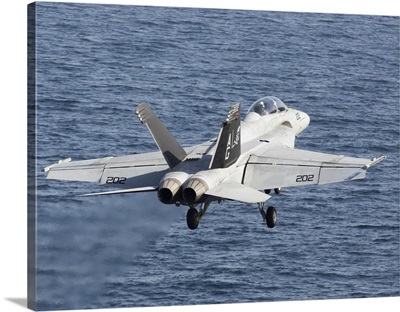 An F/A-18F Super Hornet takes off during flight operations in the Arabian Sea
