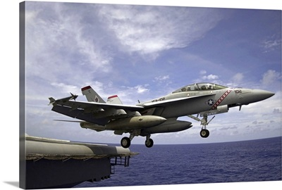 An F/A18F Super Hornet launches from the flight deck of USS Kitty