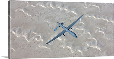 An MQ-1 Predator flies over the White Sands National Monument, New Mexico