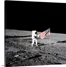 Apollo astronaut stands beside the United States flag