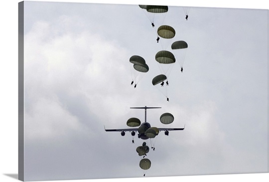 Army Soldiers jump out of a C17 Globemaster III