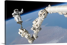 Astronaut anchored to a foot restraint on the International Space Stations Canadarm2
