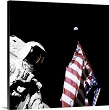 Astronaut stands next to the American flag during extravehicular activity