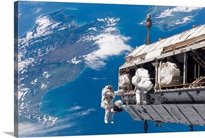 Astronauts participate in extravehicular activity