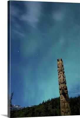 Aurora above totem pole