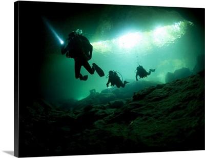 Cavern divers enter cenote system in Mexico's Yucatan Peninsula
