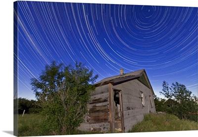 Circumpolar star trails above an old farmhouse in Alberta, Canada