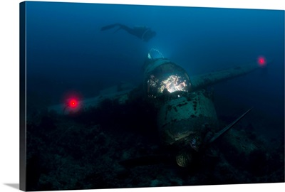 Diver exploring the wreck of a Japanese Navy Seaplane in Palau, Micronesia