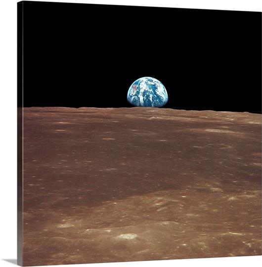 Earth rising above the Moons horizon