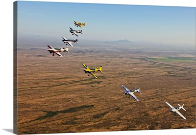 Extra 300 aerobatic aircraft fly in formation over Mesa, Arizona