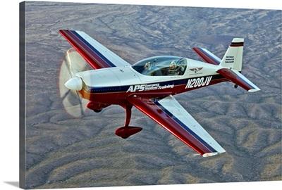 Extra 300 aerobatic aircraft over Mesa, Arizona