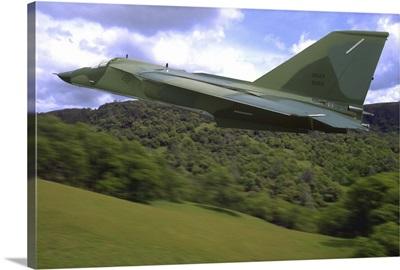 F-111 Ardvark flying over Sacramento Mountains, California
