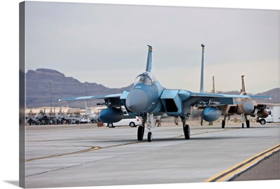 F-15C Eagles taxi to the runway at Nellis Air Force Base, Nevada