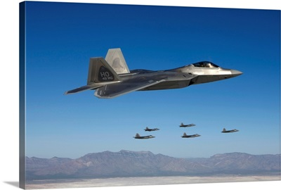F-22 Raptors fly in formation during a training mission over New Mexico