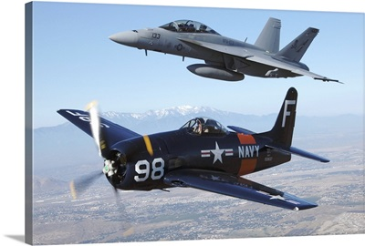 F/A-18 Hornet and F8F Bearcat flying over Chino, California