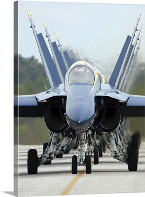 F/A-18A Hornets assigned to the Blue Angels, taxi back to their flight line
