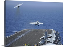 F/A-18F Super Hornets launch from the aircraft carrier USS Enterprise