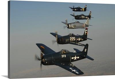 Formation of Grumman F8F Bearcats flying over Chino, California