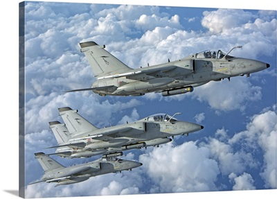 Formation of Italian Air Force AMX-ACOL aircraft over Italy