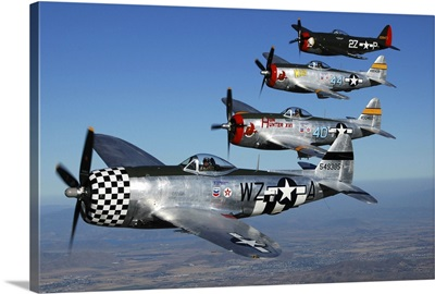 Formation of P-47 Thunderbolts flying over Chino, California