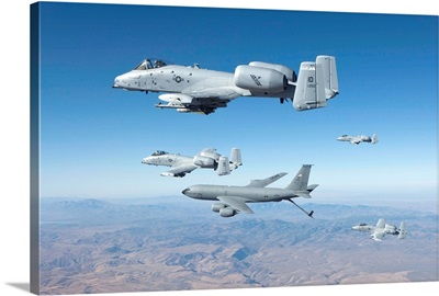 Four A-10C Thunderbolts prepare to refuel from a KC-135