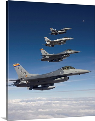 Four F-16s fly in formation during a training mission over Arizona