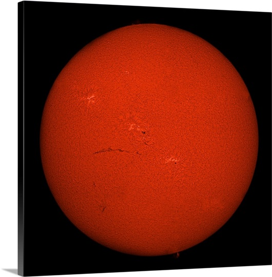 H alpha full Sun in red color with active areas and filaments