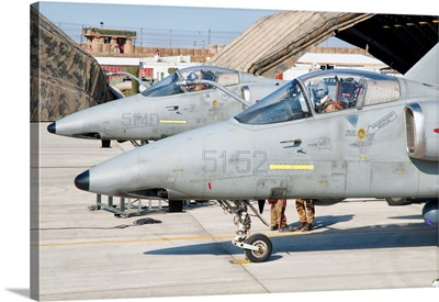 Italian Air Force AMX fighter aircraft are prepared for deployment