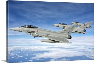 Italian Air Force F-2000 Typhoon aircraft fly in formation
